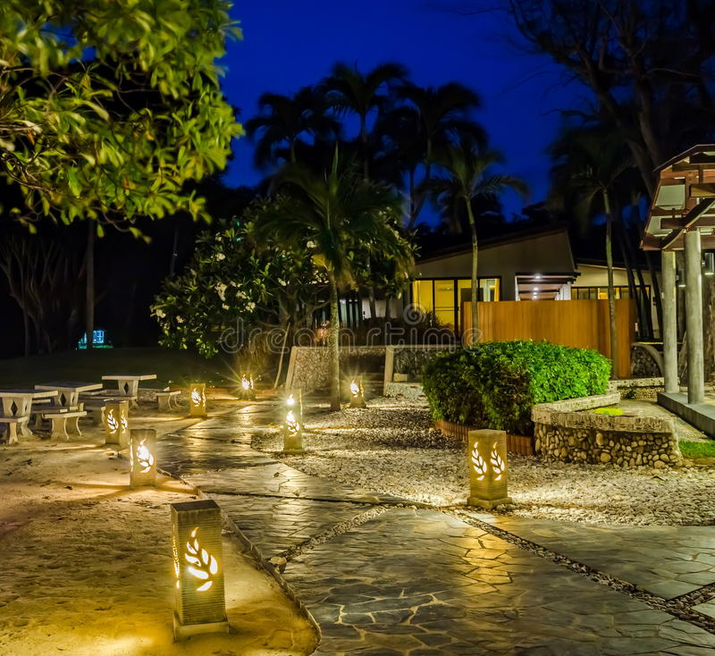 Cobblestone walk. The cobblestone walk to the resort beach house in evening royalty free stock images