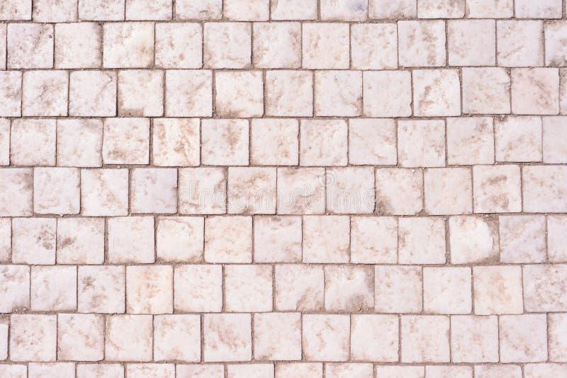 cobblestoned granittrottoar för bakgrund royaltyfri foto