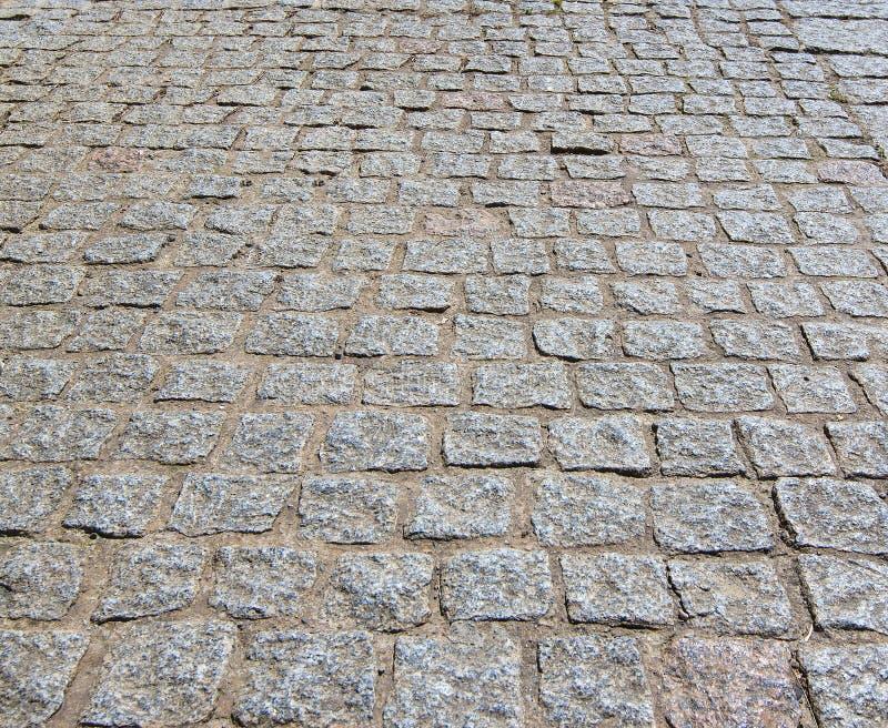 Cobblestoned Plasterungshintergrund des Granits lizenzfreies stockbild