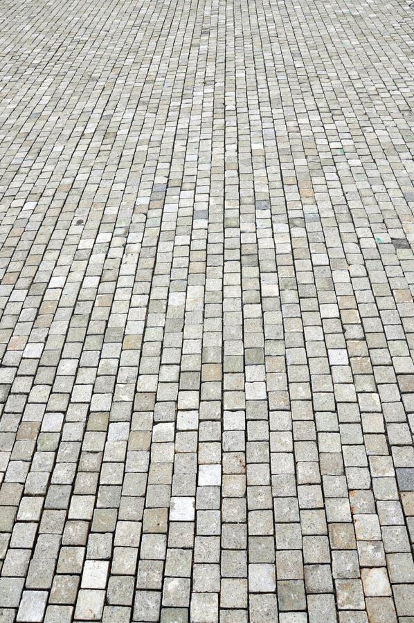 Cobblestoned Plasterungshintergrund des Granits lizenzfreie stockfotos
