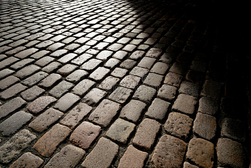 Cobblestones. In backlight at sunset royalty free stock image