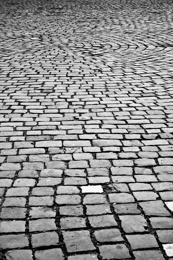 Cobblestones pavement. Grey cobblestones pavement in a square royalty free stock photography