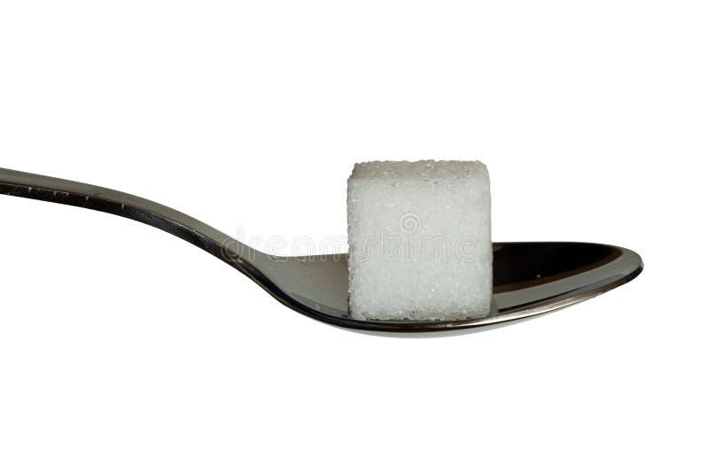 Cobe de sucre sur une cuillère à café images libres de droits