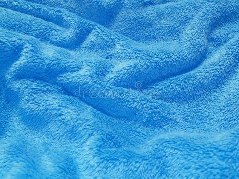 Cobertor amarrotado azul imagem de stock