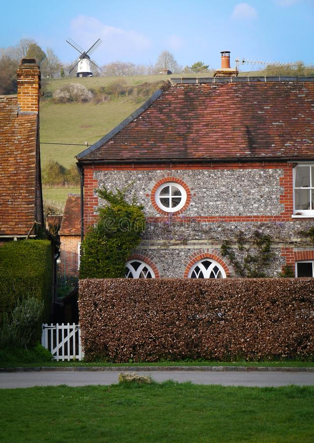 Cobstone Windmill and flint built cottage in Turville Village, Buckingham, England. stock images