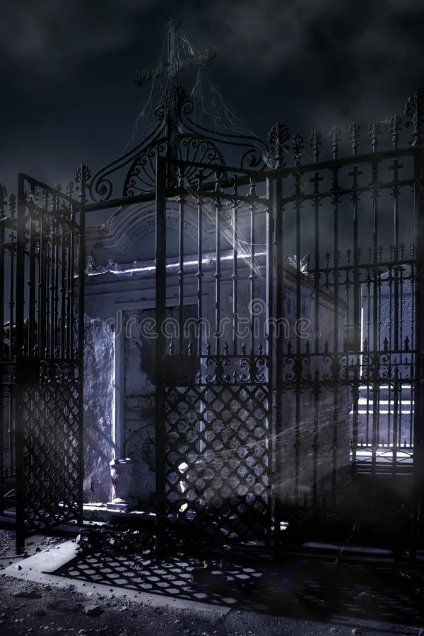 Cobweb-covered crypt bathed in moonlight stock photo