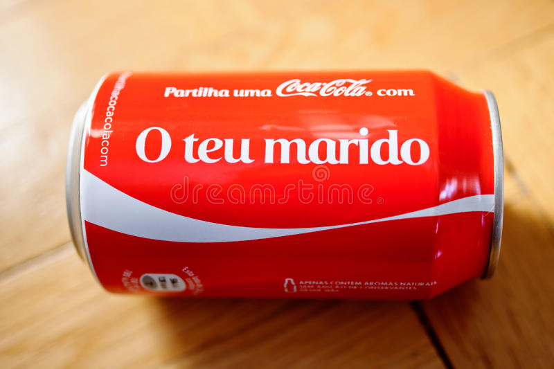 Coca-cola bootle can against wooden background O Teu Marido. PARIS, FRANCE - NOV 5 2016: Coca-Cola can with inscription in portuguese language O Teu Marido wich royalty free stock photography