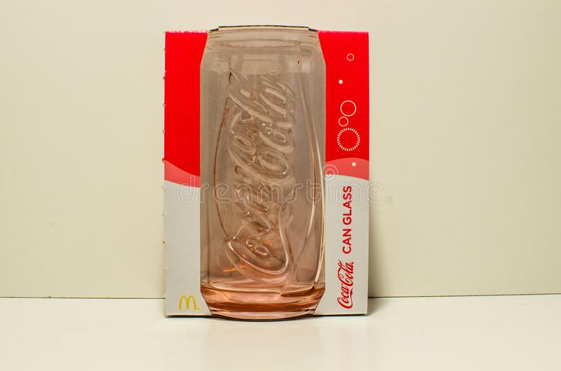 Coca Cola Coke can glass collection limited edition by McDonald Australia ,in original package in red color. SYDNEY, AUSTRALIA. – On December 20, 2017. - Coca royalty free stock photography