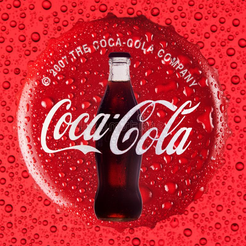 Free Coca Cola Drink Concept On A Red Background With A Cap And A Bottle With Drops Royalty Free Stock Photos - 159732568