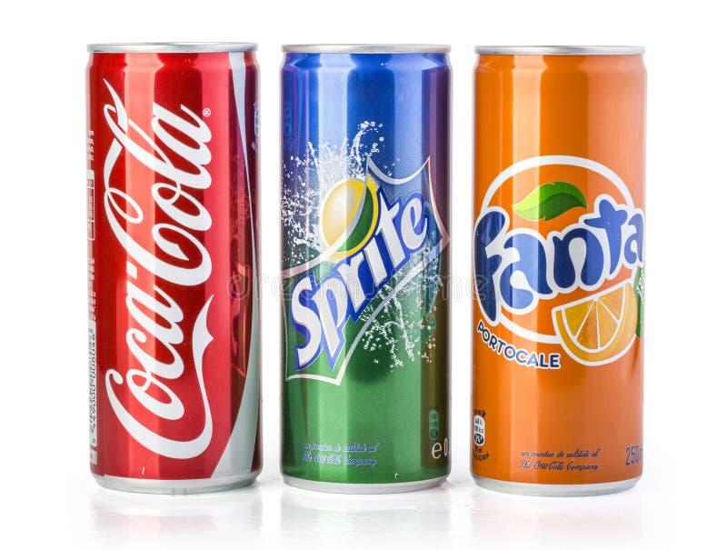 Coca - cola, Fanta och Sprite cans som isoleras på vit arkivfoto