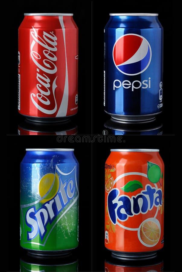 Coca-cola, pepsi-cola, fanta, latte di sprite fotografia stock