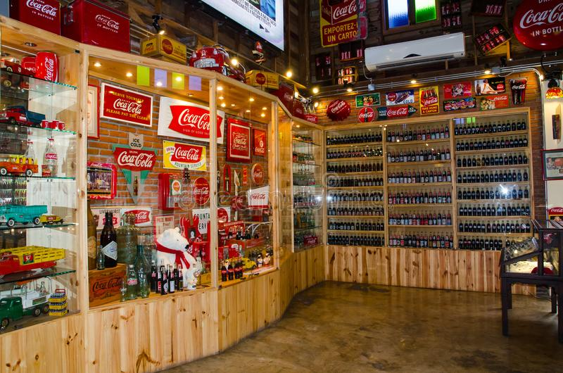 The coca cola retro product collection in the display shelf at the Coca Cola Museum `Baan Bang Khen` royalty free stock photos