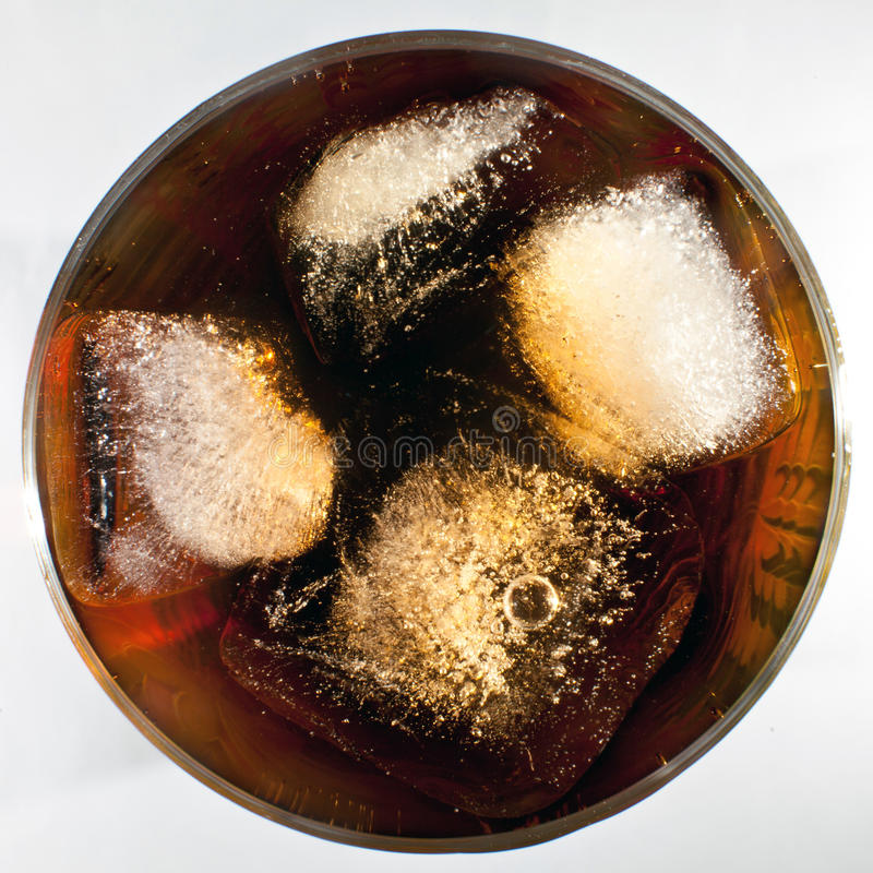Coca with ice in a glass stock photography