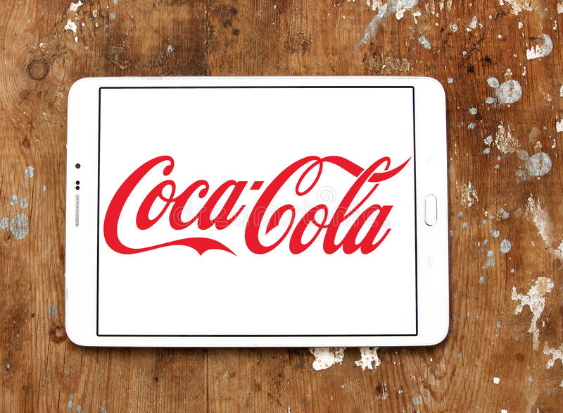Cocacola logo. Logo of drinks company cocacola on samsung tablet on wooden background stock photo