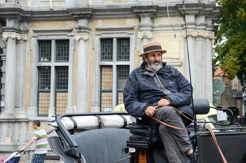 Cocchiere del trasporto del cavallo al quadrato di Grote Markt Bruges Bruges immagini stock libere da diritti