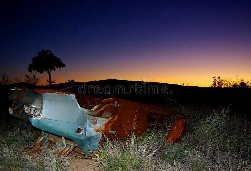 Coche abandonado, interior puesta del sol imagen de archivo libre de regalías