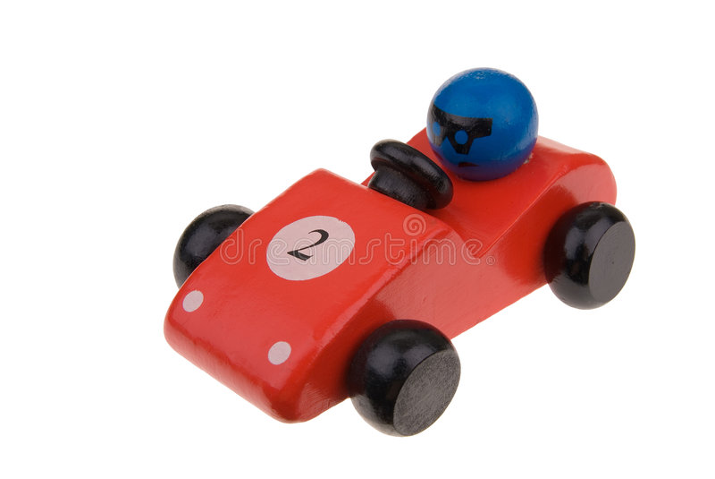 Coche de carreras de madera rojo del juguete foto de archivo