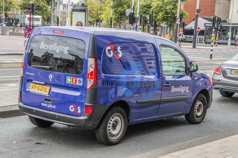 Coche de G4S Security Company en Amsterdam el coche holandés de 2018G4S Security Company en Amsterdam el 2018 holandés imágenes de archivo libres de regalías