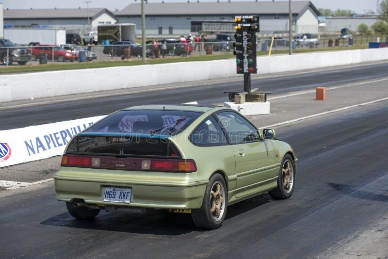 Coche de Honda en la pista foto de archivo