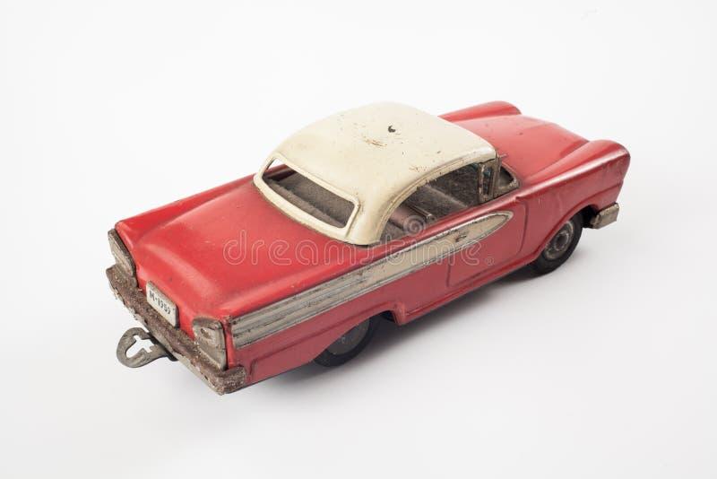 Coche de metal rojo del juguete del vintage fotografía de archivo