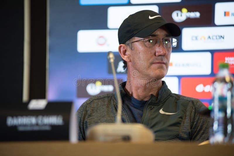 Coche de tenis Darren Cahill durante rueda de prensa imagen de archivo