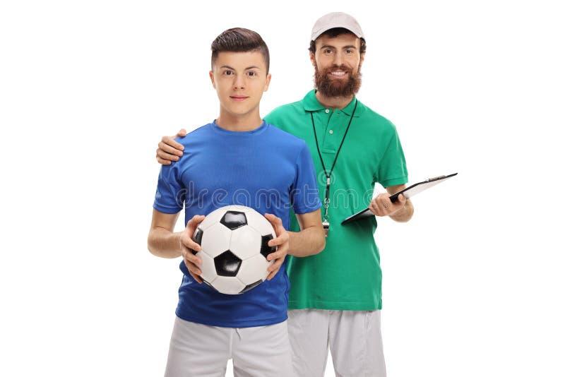 Coche del fútbol con un jugador adolescente foto de archivo