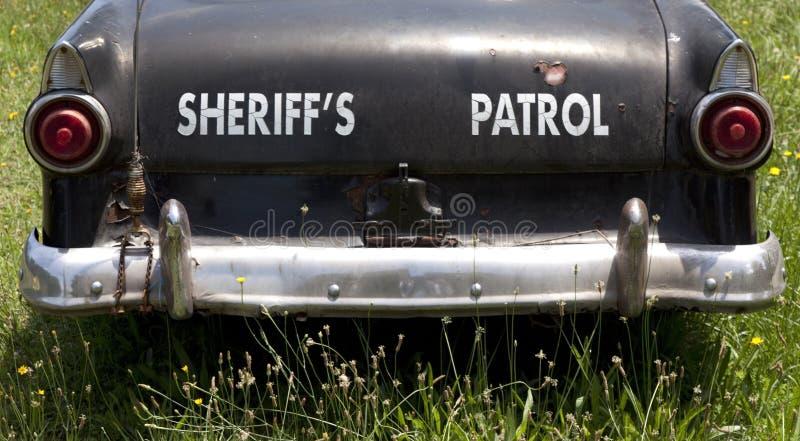 Coche patrulla blanco y negro del ` s del sheriff del vintage fotos de archivo libres de regalías