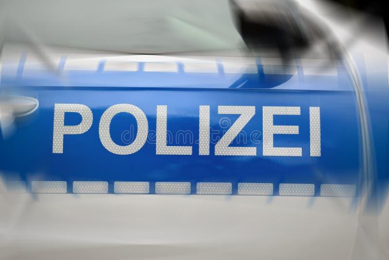Coche policía alemán que pone letras al detalle fotos de archivo