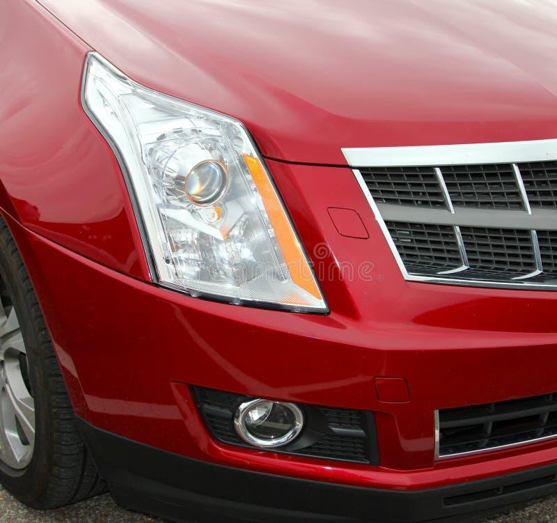 Coche rojo Front Quarter de parachoques del coche imágenes de archivo libres de regalías