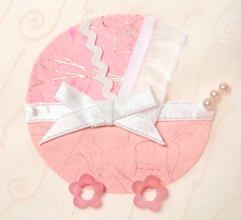 Cochecito de niño rosado decorativo imagenes de archivo
