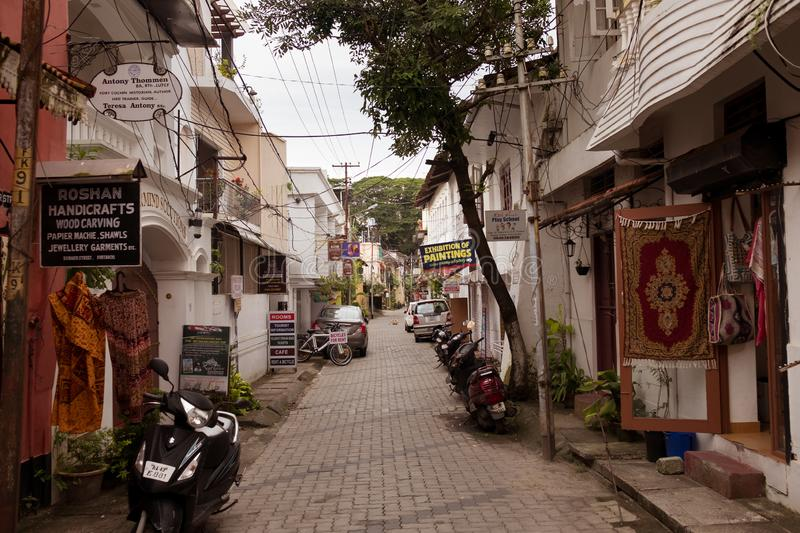 Cochin, India - 20 september 2019: view of old town alley street in the kerala city with neocolonial classic architecture and. Handicrafts shops and stalls stock photography