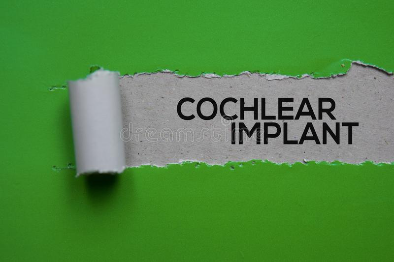 Cochlear Implant Text written in torn paper. Medical concept stock photos