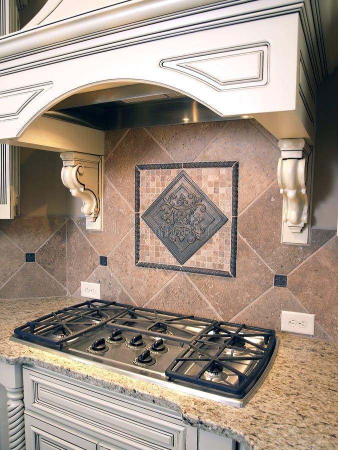 Cocina de lujo Cooktop con el capo motor 2 fotos de archivo