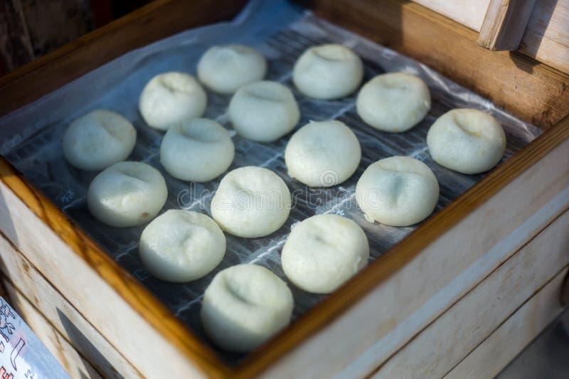 Cocinar la comida china fotos de archivo