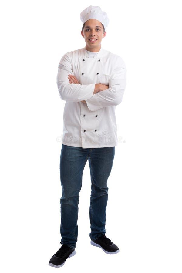 Cocine al aprendiz del aprendiz que cocina con el hombre joven del trabajo que coloca el aislador fotografía de archivo libre de regalías