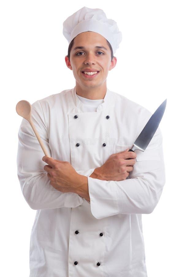 Cocine al aprendiz del aprendiz que cocina con los jóvenes del trabajo del cuchillo aislados imagen de archivo