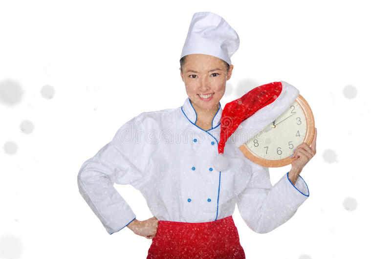 Cocinero asiático con el reloj y el sombrero de la Navidad foto de archivo libre de regalías