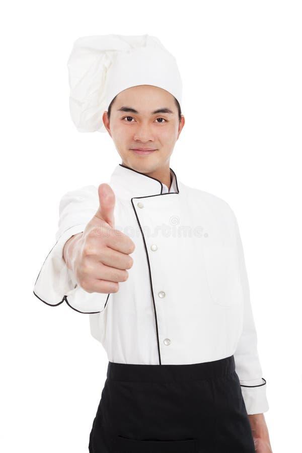 Cocinero joven con el pulgar para arriba imagen de archivo libre de regalías