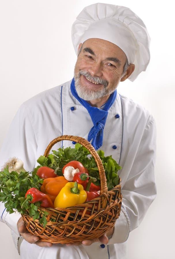 Cocinero atractivo feliz imágenes de archivo libres de regalías