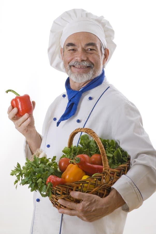 Cocinero atractivo feliz fotos de archivo
