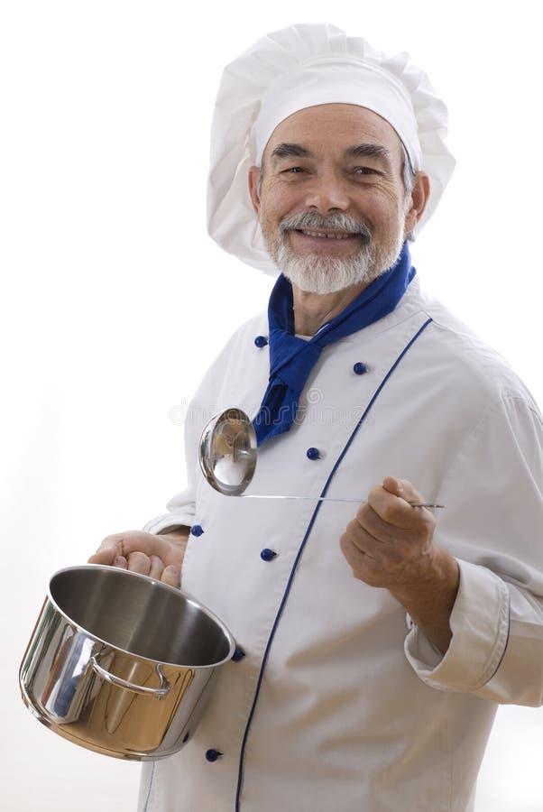Cocinero atractivo feliz foto de archivo