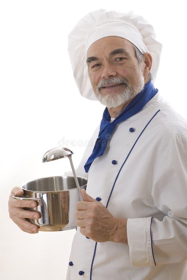 Cocinero atractivo feliz imagenes de archivo