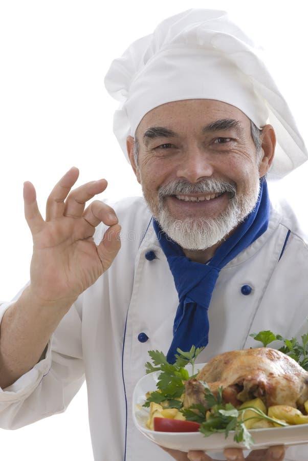 Cocinero atractivo feliz fotografía de archivo libre de regalías