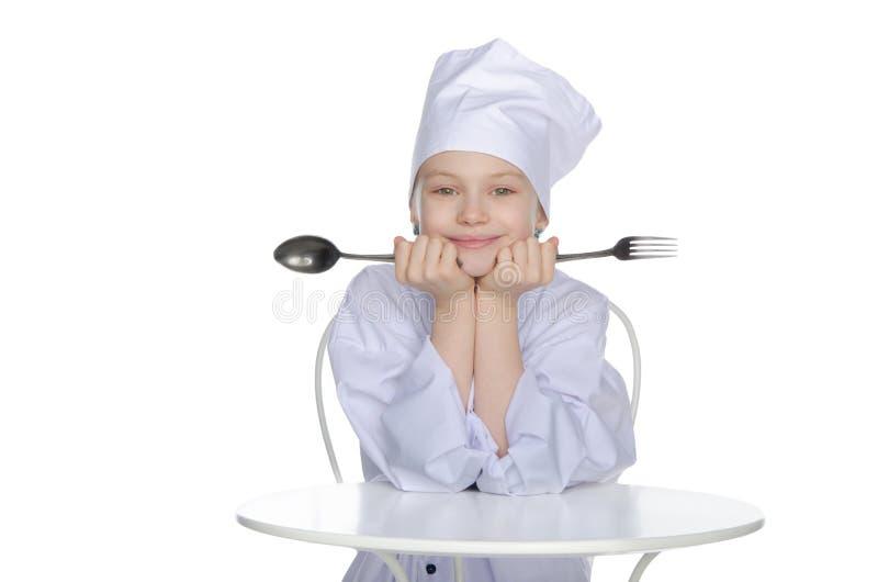 Cocinero con la bifurcación y la cuchara imagen de archivo libre de regalías