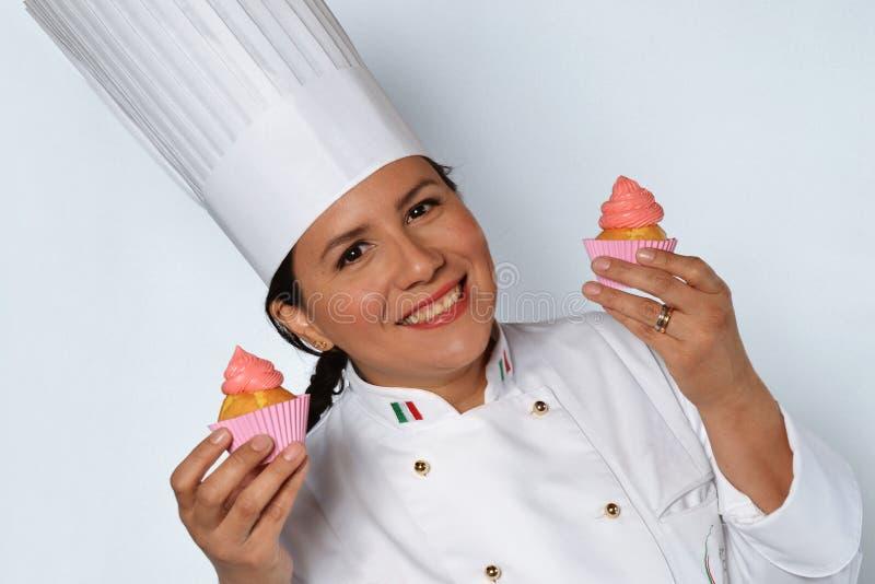 Cocinero de la mujer de los pasteles imágenes de archivo libres de regalías