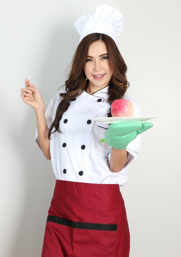Cocinero de la mujer joven imagen de archivo libre de regalías