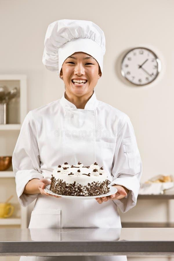 Download Cocinero De La Panadería En Blancos De La Toca Y De Los Cocineros Imagen de archivo - Imagen de toque, torta: 7150361
