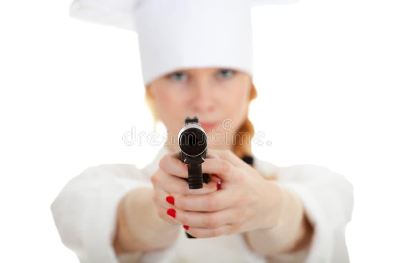 Cocinero de la señora con el arma imagenes de archivo