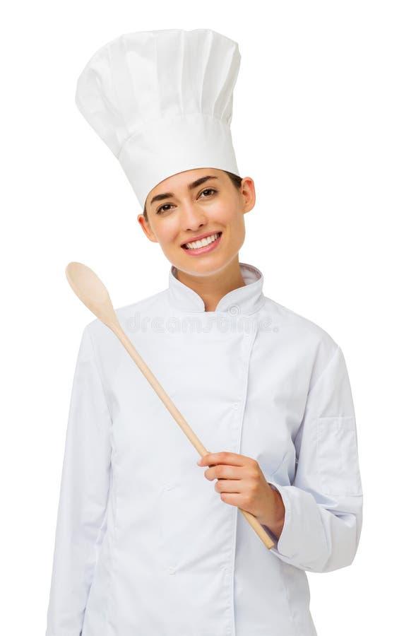 Cocinero de sexo femenino confiado Holding Wooden Spoon foto de archivo