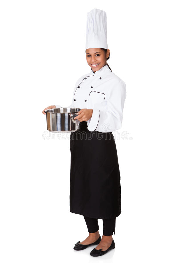 Cocinero de sexo femenino With Cooking Pot a disposición imagen de archivo